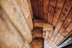 Detail of beams in cabin wall. Painted wood with fungicide paint. With the roof elements royalty free stock photography