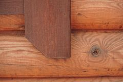 Detail of beams in cabin wall. Painted wood with fungicide paint. With the window elements royalty free stock photos