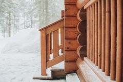 Detail of beams in cabin wall. Painted wood with fungicide paint. The railing of the veranda another view close with the snow royalty free stock image