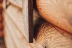 Detail of beams in cabin wall. Painted wood with fungicide paint. With the window elements another view stock image