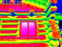 Detail of beams in cabin wall. Traditional construction of wooden house in  thermography scan. Stock Photography