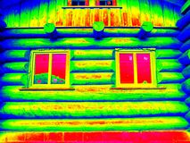 Detail of beams in cabin wall. Traditional construction of wooden house in  thermography scan. Royalty Free Stock Photo