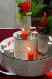 Detail of beautiful candle and floral decorations with red ribbo Stock Photo