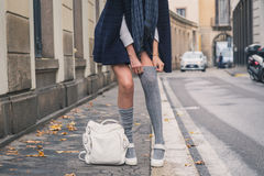 Detail of a beautiful girl posing in the city streets Stock Photo