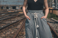 Detail of a beautiful girl posing in an industrial context Royalty Free Stock Photo