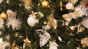 Detail from a beautiful illuminated christmas tree stock video footage