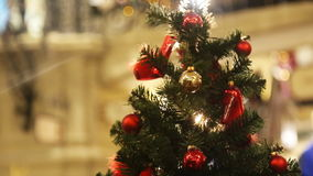 Detail from a beautiful illuminated christmas tree stock footage