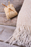 Detail of a beautiful knitted scarf with fringe. Royalty Free Stock Photo
