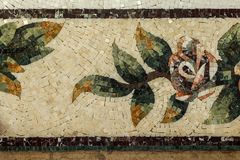 Detail of a beautiful marble mosaic panel. Interior marble mosaic. A piece of marble Venetian mosaic as a decorative background. Selective focus royalty free stock images