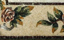 Detail of a beautiful marble mosaic panel. Interior marble mosaic. A piece of marble Venetian mosaic as a decorative background. Selective focus stock photos