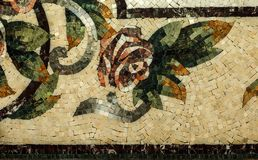 Detail of a beautiful marble mosaic panel. Interior marble mosaic. A piece of marble Venetian mosaic as a decorative background. Selective focus royalty free stock photo