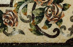 Detail of a beautiful marble mosaic panel. Interior marble mosaic. A piece of marble Venetian mosaic as a decorative background. Selective focus stock photo