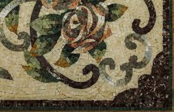 Detail of a beautiful marble mosaic panel. Interior marble mosaic. A piece of marble Venetian mosaic as a decorative background. Selective focus royalty free stock image