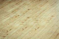 Detail of a beautiful wooden brown laminated floor. Close up detail of a beautiful wooden brown laminated floor royalty free stock photos
