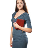 Detail of a beautiful young businesswoman holding a notebook Royalty Free Stock Photography