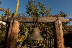 Bell in courtyard of San Juan Bautista mission , California, USA. royalty free stock photography