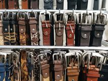 Detail of belts. In a market stall stock photos