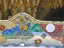 Detail of a bench of cut colored ceramics in the Parc Guel of Barcelona in Spain royalty free stock photos