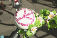 Detail of a bicycle`s rounded ring bell with sign of `Peace` Royalty Free Stock Image