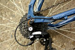 Detail of a bicycle wheel with spokes, chain and gearshift hub. royalty free stock photo