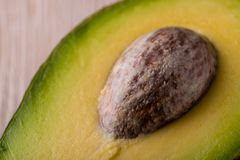 Detail of big avocado core in half of fruit Royalty Free Stock Image