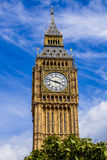 Detail of the Big Ben clock tower  surrounded by a pretty blue Stock Photo