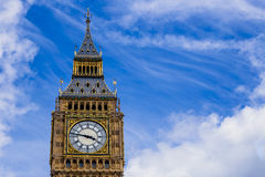 Detail of the Big Ben clock tower  surrounded by a pretty blue Stock Images