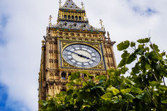 Detail of the Big Ben clock tower  surrounded by a pretty blue Royalty Free Stock Photo