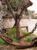 Detail of a big old rusty anchor used for decoration. In Croatia Stock Images