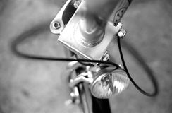 Detail of bike 3. The front wheel and light of a bike in black and white Royalty Free Stock Image