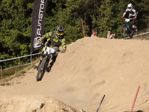 Detail of bikers on jumps - editorial Stock Image