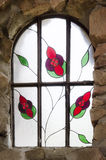 Detail of Bishops Castle in Colorado. Stained glass window that is in Bishops Castle. Beautiful color and craftsmanship Royalty Free Stock Photo