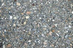 Colorful asphalt. Detail of a bituminized road with stones in different colors Royalty Free Stock Images