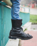 Detail of black boot in a city park Stock Photos