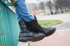 Detail of black boots in a city park Royalty Free Stock Photography