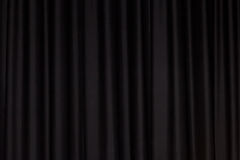 Black curtain. Detail of a black closed curtain in a theatre Stock Photo