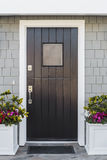Detail of black front door to home stock photography