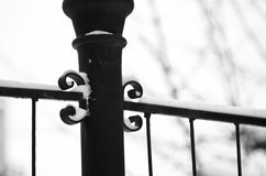 Detail of a black metal fence on a white snow background during winter. At Kosutnjak park, Belgrade, Serbia Stock Image