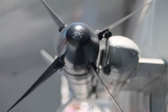Detail of black missile with fins on F14 tomcat jet Royalty Free Stock Image