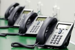 Detail of black phones in call center stock photo