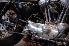 Detail of black, silver and chromed motorcycle. Front view royalty free stock image