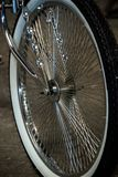 Detail of the black wheel of a custom chrome bicycle royalty free stock images