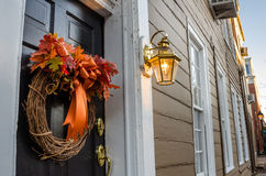 Detail of a Black Wooden Front Door. With a Hanging Autumnal Wreath. Old Town Alexandria, VA, USA Stock Photo
