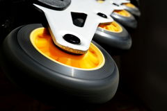 Detail of a black and yellow roller skates (in-line skates) in the darkness as a symbol of movement and speed Royalty Free Stock Images