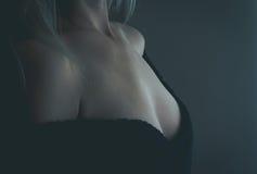 Detail. Blond woman breast detail shot stock photos