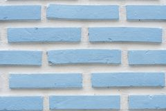 Detail of a blue brick wall texture. White background stock photography