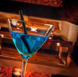 Detail of blue cocktail drink on a lounge bar table Stock Photo
