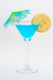 Detail of blue cocktail with lemon and umbrella Royalty Free Stock Image