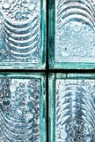 Detail of blue colored glass block bricks against the light stock images