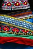 Detail of ethnic minorities costume. Detail of blue and green ethnic minorities costume from china stock photos